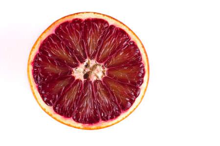 cut fruit: half of red blood sicilian orange isolated on white