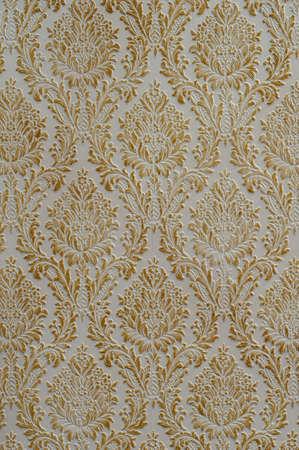 stylishness: golden rose ornament on white background texture