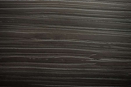 plastered wall: Background black textured plastered wall dark horizontal