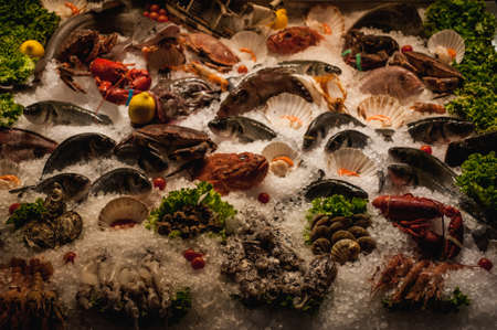 fish exhibition: fresh seafood displayed on ice in front of restaurant