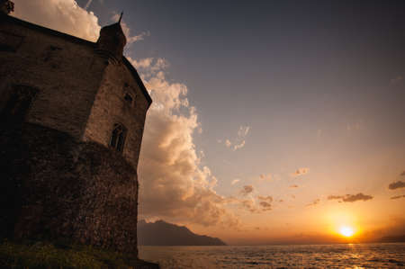 chillon: Chillon Castle in Switzerland during the sunset. May, 2015