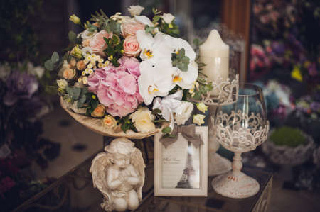 funeral background: beautiful delicate bridal bouquet on the table. floral wedding theme. Stock Photo