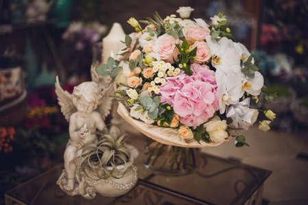arrangement: beautiful delicate bridal bouquet on the table. floral wedding theme. Stock Photo