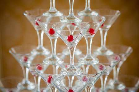 celebration event: Pyramid of glasses of champagne with cherry