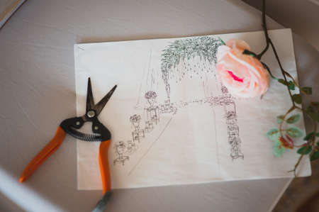 wedding decor: wedding decor sketch on paper and scissors