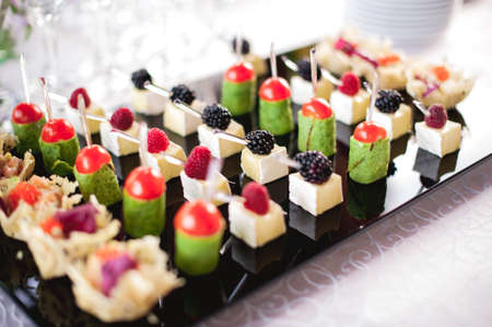 mixed fingerfood and canapes on appetizer table