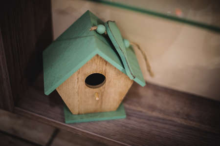 vibrant cottage: a wooden birdhouse. decorative blue nesting box