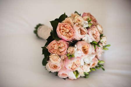 silken: wedding bouquet on a white silken sheet