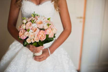 no face: Bride with a wedding bouquet. no face