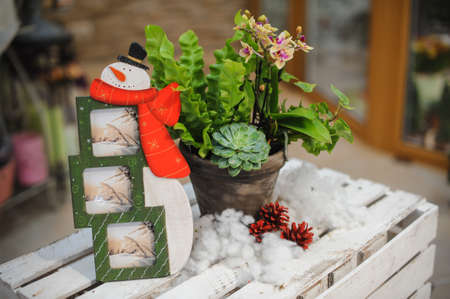 enabling: snowman shape photo frame in winter composition Stock Photo
