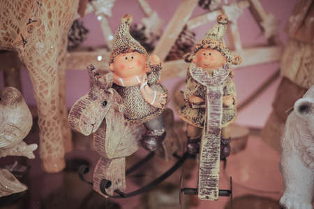 craft material tinker: Couple of two children statue for christmas decoration. on sheelf