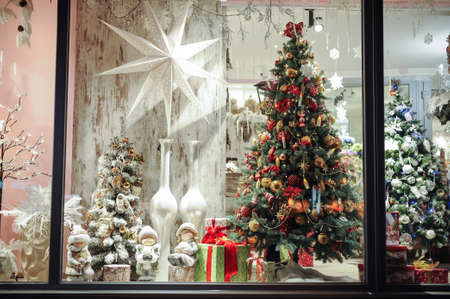 shop window: Gift boxes , sweets and christmas decor in the shop window