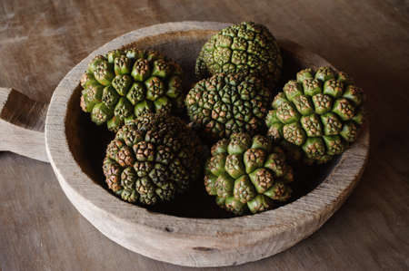screwpine: A group of Fruits Of Pandanus Tree in wooden bowl Stock Photo