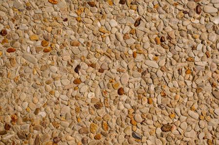 exposed concrete: exposed aggregate concrete texture background beige stone