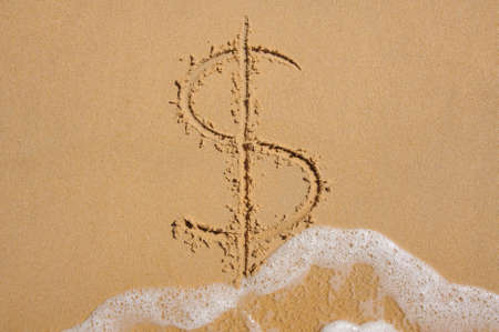 meltdown: Dollar sign in beach sand being washed away by wave