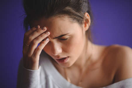 beautiful sad: Closeup portrait young upset sad woman thinking deeply about something with headache holding her hands Negative human facial expression