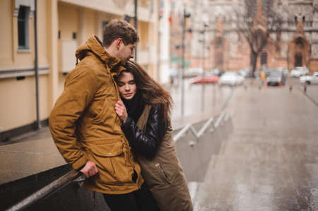 fall winter: Young couple in love hugging outdoor autumn
