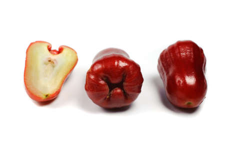 bell shaped: Rose apple or chomphu whole and half isolated on white background Stock Photo