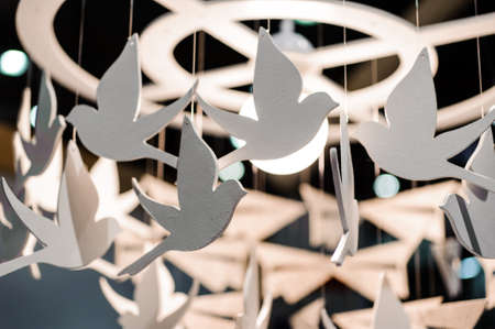 hand made: lamp decorated with white birds hand made Stock Photo