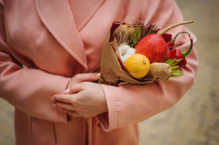 unusual vegetables: The original unusual edible bouquet of vegetables and fruits on  wood