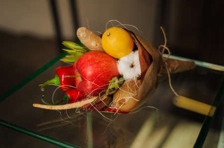 unusual vegetables: The original unusual edible bouquet of vegetables and fruits on  glass table Stock Photo
