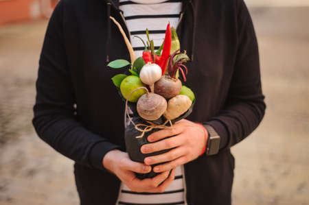 unusual vegetables: The original unusual edible bouquet of vegetables and fruits in man hands