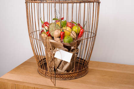 unusual vegetables: The original unusual edible bouquet of vegetables and fruits on  wood with card in bird cage