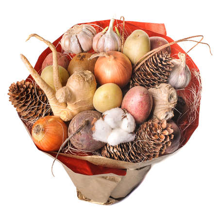 unusual vegetables: The original unusual edible bouquet of vegetables and fruits isolated on white