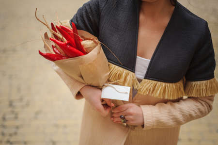unusual vegetables: The original unusual edible bouquet of vegetables and fruits on  wood with card in woman hands Stock Photo