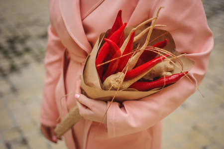 unusual vegetables: The original unusual edible bouquet of vegetables and fruits  woman hands