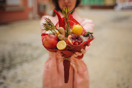 unusual vegetables: The original unusual edible bouquet of vegetables and fruits in woman hands