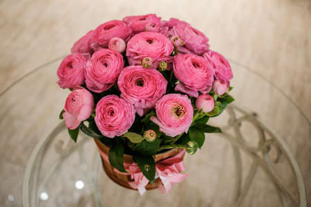 persian buttercup: Pink persian buttercup flowers ranunculus bouquet on table