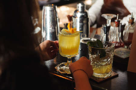 no face: Barman is decorating cocktail with lemon no face