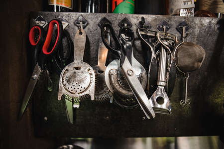 barware: Set of barman equipment hanging on working place Stock Photo
