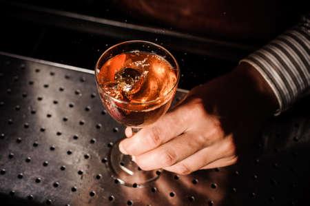 barman: Barman at work, serving cocktails at bar . no face