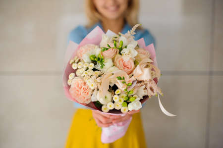 no face: girl holding a bouquet of white flowers no face Stock Photo