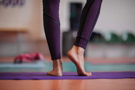 prime adult: woman standing barefoot at yoga class. no face Stock Photo