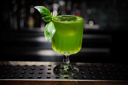 green gin basil smash cocktail at the bar