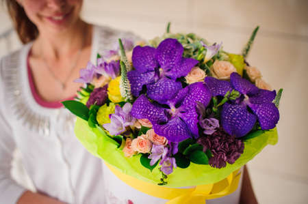 valentines day mother s: Beautiful tender purple bouquet of flowers in white box Stock Photo