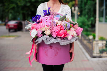 valentines day mother s: Beautiful tender purple bouquet of flowers in pink box Stock Photo