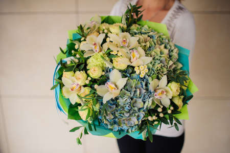 no face: Woman holds a green bouquet no face Stock Photo