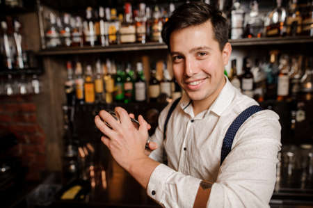 close up smiling bartender Stock Photo