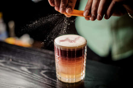 Bartender decorates New York sour cocktail no face