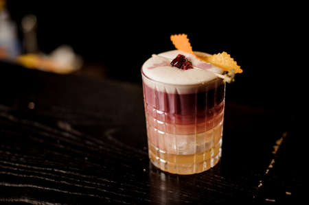 New York Sour Cocktail with foam and wooden backround.