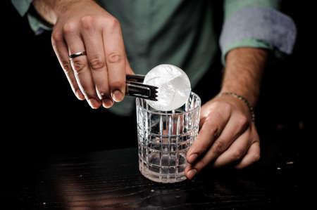 bartending concept hand cut ice ball close up