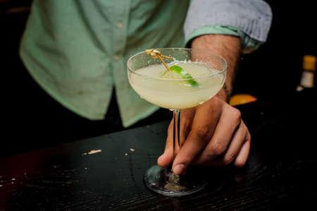 Bartender making cocktail with lime close up Lizenzfreie Bilder
