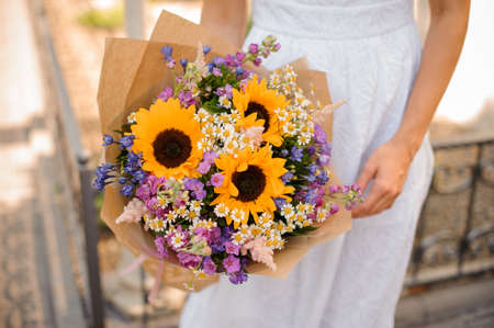 sunflower wedding bouquet in the hands of the bride. No face Stock Photo