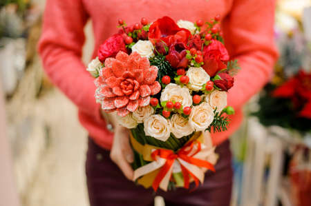 Little and pretty winter bouquet of red flowers in woman hands little and pretty winter bouquet of red flowers in woman hands stock photo picture and royalty free image image 87788405 mightylinksfo