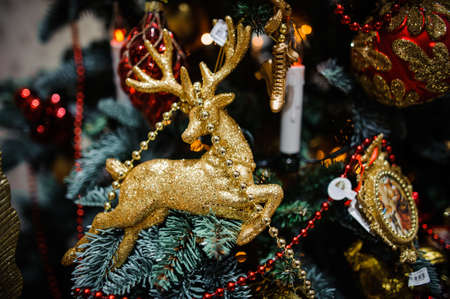 christmastime: Christmas tree decoration toy in the form of golden deer
