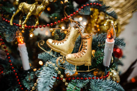 christmastide: Christmas tree decoration toy in the form of golden skates